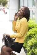 Smiling woman talking on phone Stock Photos