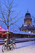 Gendarmenmarkt, Snowy bicycle parked against bare tree - stock photo