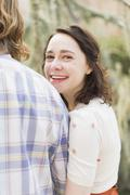 Stock Photo of Young smiling woman next to boyfriend