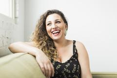 Stock Photo of Woman looking away and laughing
