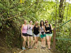 Young women on footpath in forest Stock Photos