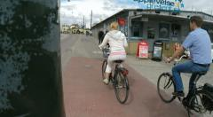 Cyclists in Stockholm with and without helmets Stock Footage