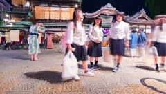 Time-lapse of people and traffic surrounding the ancient Japanese bathhouse Dogo - stock footage