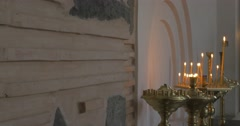 Stock Video Footage of Burning Candles in Three Candlesticks John The Baptist Church Separeted Temple