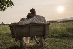 Young couple in love outdoor at the sunset - stock photo
