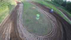 2.7k drone follow mx racer through corners Stock Footage