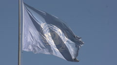 United Nations Flag on blue sky, slow motion - stock footage