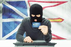 Hacker with Canadian province flag on background - Newfoundland and Labrador Stock Photos