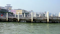 A peaceful view of empty mooring posts at Macau Fisherman's Wharf Stock Footage