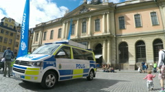 Swedish police van in Stockholm in Summer sunshine Stock Footage