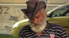 Authentic emotion homeless man senior sitting on a bench Stock Footage