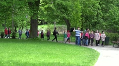 Kids excursion with guide in green botanical garden park. 4K Stock Footage