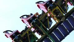 Stall with people in the attraction roller coaster rides in the Russian top Stock Footage