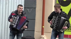 Stock Video Footage of young boy duet play with accordion on street. 4K