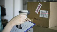 Scanning boxes with barcode scanner Stock Footage