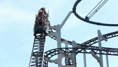 Russian roller coaster ride, people rushing down the mountain on an attraction - stock footage