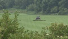 Tractor mowing turf. - stock footage