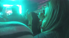 Happy young woman in crowd of pop music fans applauding, enjoying performance - stock footage