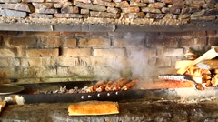 Burning wood in the hearth, barbecue grills, fireplaces and smoke Stock Footage