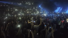 Many young people filming concert on smartphones. Addiction to gadgets, problem Stock Footage