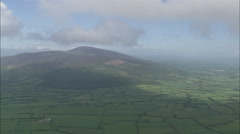AERIAL Ireland-Flight Past Clouds And Hill Stock Footage