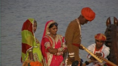 Indian marriage music and dancers by boat on the lake Stock Footage