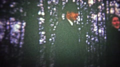 VERMONT, USA - 1947: Woman pranking couple by shaking tree snow on them. Stock Footage