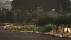 Panning shot of a street in a rural area in the USA. Stock Footage