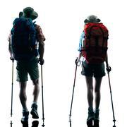 Couple trekker trekking nature silhouette walking Stock Photos