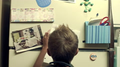Student posting grade on the refrigerator. Stock Footage
