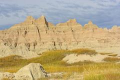 Colorful Badlands Formations Against Stormy Skies Stock Photos