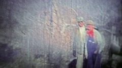 TENNESSEE, USA - 1952: Deer hunters clean and skin the kill out in the forest. Stock Footage