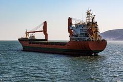 Cargo Ship Sailing in Ocean Stock Photos