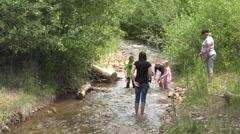Children racing homemade rafts mountain creek 4K 022 Stock Footage