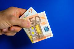 hand give one banknote - stock photo