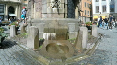 Small Fountain in Stockholm Old Town in Summer sunshine Stock Footage
