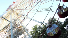 People ride on the Ferris wheel at the town festival - stock footage