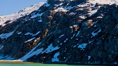 View of a big ice glacier and snow covered mountains in Glacier Bay. Stock Footage