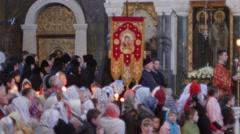 Stock Video Footage of Parishioners at a festive service Kievo-Pecherska Lavra. Church Banner The