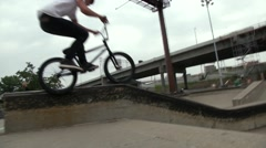 Extreme Sport BMX Bike Rider Grinding a Ledge in an Urban Environment Stock Footage