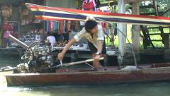 Guy drive longtail. Thai floating boat market at khlong canal. Thailand Stock Footage