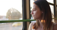 Pretty young girl traveling by tram Stock Footage