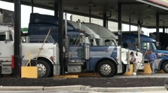 Truckers at a Rest Stop Cleaning their Trucks Stock Footage