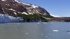 Big snow glacier and snow capped mountains from the back of a cruise ship in Stock Footage