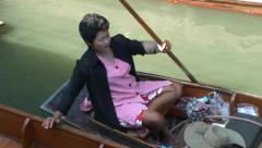 Woman take off cap. Thai floating boat market at khlong canal. Thailand Stock Footage