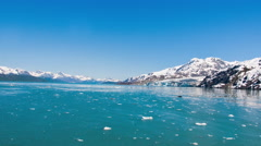 Slow traveling time lapse of snow capped mountains along Glacier Bay, AK Stock Footage