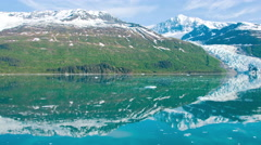 Traveling time-lapse of the glassy water with icebergs in College Fjord, Alaska. Stock Footage
