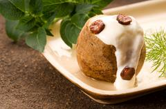 Baked potato with sour cream, greaves and fresh dill Stock Photos