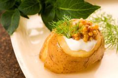 Baked potato with sour cream, grain Dijon mustard and herbs Stock Photos