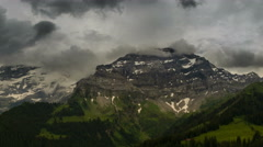 Les Diablerets peak being enveloped in clouds time lapse summer landscape 4K Stock Footage